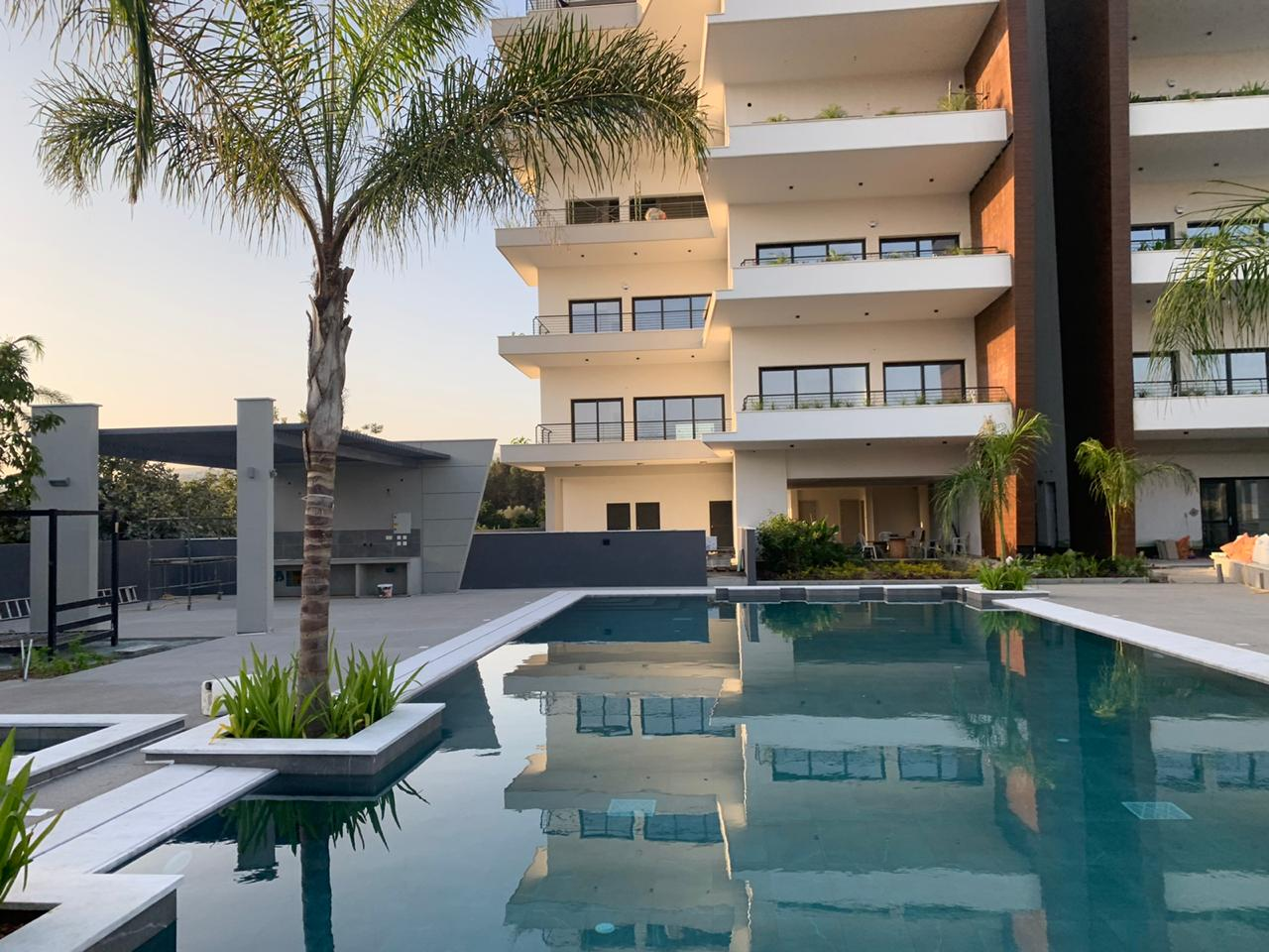 Royal Gardens Residences Front View With Pool